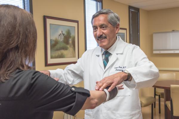 Dr. Arce examining a patient