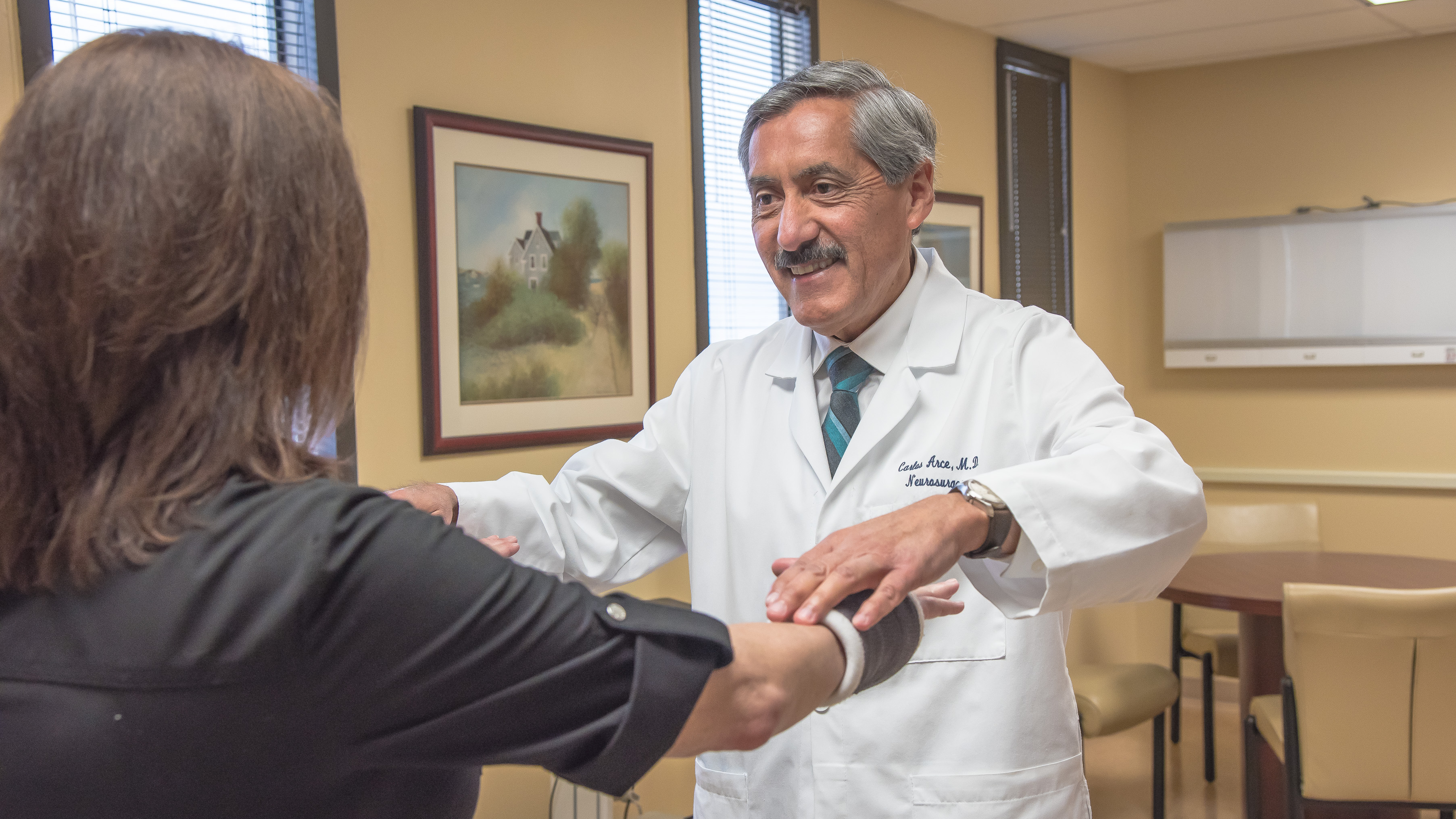 Dr. Arce examining a patient.