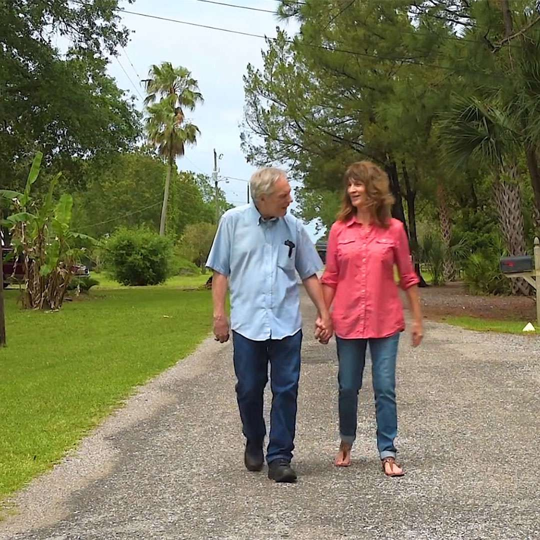 John Clemens takes a walk with wife Darlene after undergoing deep brain stimulation surgery to control his Parkinson's tremors.