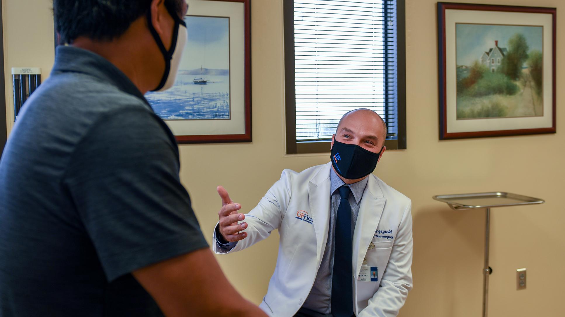 Dr. Brzezicki seeing a patient
